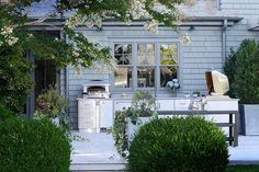 The deck of a Hamptons estate is outfitted with stainless-steel appliances by Kalamazoo
