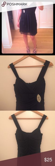"""Navy blue cocktail dress Navy blue cocktail dress with rhinestone appliqué. Draped bottom. The dress has a sheer overlay of navy fabric over a lining. Sheer straps. Built in cups, so no need for an annoying strapless bra! Perfect for a wedding or other semi formal event. Goes great with silver jewelry! The tag says medium, but I couldn't get it zipped all the way (I'm a size 6) and the busy measures just barely 26"""", so it's best for someone closer to a size 2 or 4. Dresses"""
