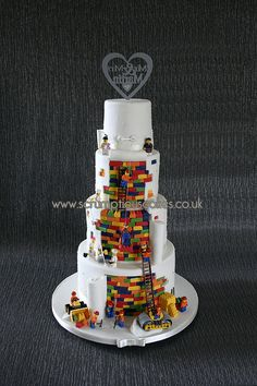 I first made this cake last year and as soon as it was put on my page I received an order for it for a few weeks ago. I love making these plain front and busy back cakes and it seems to have inspired a few lego wedding cakes since then! Lego Wedding Cakes, 4 Tier Wedding Cake, Themed Wedding Cakes, Mini Cakes, Cupcake Cakes, Cupcakes, Buckwheat Cake, Zucchini Cake, Lego Cake