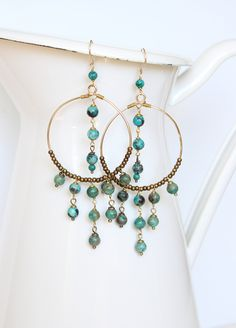 Boho Chic Chandelier Earrings - Turquoise, Antique Brass and Gold. $54.00, via Etsy.