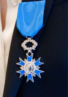 "Nathalie Paillarse, Knight of the French National Order of Merit (""Chevalier de l'Ordre National du Merite"")"