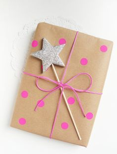 Simple Star Gift Topper: This present presentation is perfect for the girly girl in your life. Who doesn't love glittered stars and pink polka dots? Bonus: Now she has a wand.