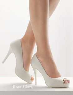 Zapatos de novia blancos de tacón alto