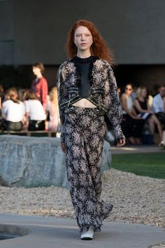 A model walks the runway at the Louis Vuitton Cruise Show