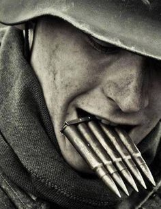 A soldier of the Wehrmacht holds his Five Clip in his mouth as he fumbles around and reloads his Karabiner 98 rifle. German Soldiers Ww2, German Army, Military Art, Military History, Ww2 History, Grandparent Photo, Retro Mode, War Photography, Graphics