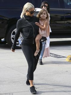 A doting aunt as well: The Kardashian Kollection designer looked lovingly at her niece as they walked away from the large black SUV
