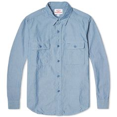 A relaxed piece of shirting designed to withstand a hard day in the workshop or a good day on the trail, the Battenwear Work Shirt is cut from a 100% cotton chambray and is constructed with hard wearing flat fell seams. Featuring a slightly pointed spread collar, two chest pockets with a classic pencil pocket eyelet, it is finished with a curved hem.  100% Cotton Chambray Spread Collar Two Chest Pockets Curved Hem Made in the USA