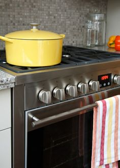 Yellow La Creuset pot/ Porter & Charles gas range/ styling kitchen detial