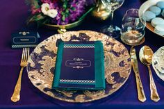 Peacock blue green gold wedding table decoration and stationary