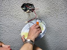 HOW TO REPLACE A LIGHT FIXTURE WITH A CEILING FAN - Save heating and cooling costs by replacing an existing light fixture with an energy-efficent fan/light combination.