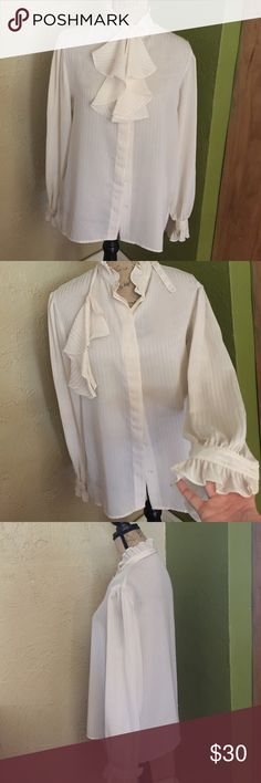 Vintage button down blouse Excellent condition top, with ruffle attachement, no tags fits size medium/large- gorgeous belled sleeves and ruffle collar , great piece to add to vintage collection Vintage Tops Button Down Shirts