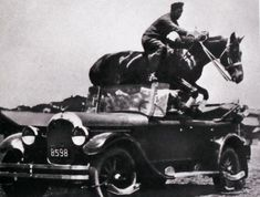 Colonel Takeichi Nishi jumping trough his car with his horse Uranus. He was a Japanese Imperial Army officer, equestrian show jumper, and Olympic Gold Medalist at the 1932 Los Angeles Olympics. He was a tank unit commander at the Battle of Iwo Jima and was killed in action during the defense of the island.