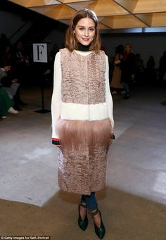 Different: Olivia Palermo modeled a sleeveless fur coat that had at least three different ...