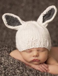 Our sweet new hand knit bunny hat. Choose white with gray ears or white with pink ears. The perfect gift for little bunnies everywhere. Hand knit from 100% super soft acrylic. Sizing Guide: Newborn (0