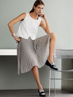 Who What Wear Blog 12 Minimal Work Perfect Looks Mango Lookbook Model Malgosia Bela Workwear Inspiration Sleeveless Top Pleated Skirt