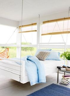 I saw this idea once in a Southern Living magazine back in High School and have always dreams of having one.....Porch Swing Beds!  The one I...