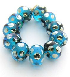 EDJ - Aqua Flash  Handmade Glass Lampwork Beads SRA USA Artist Eric Larson. $22.00, via Etsy.