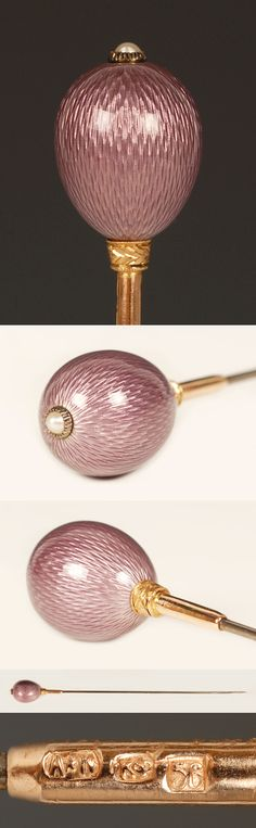A Faberge Gold Mounted Guilloche Enamel Hat Pin, workmaster August Hollming, St. Petersburg, circa 1890. Of egg form, enameled in translucent mauve over hatched engine turned ground, chased leaf collars, and a pearl-set terminal