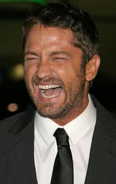 Gerard Butler laughing at premiere of PS I Love You