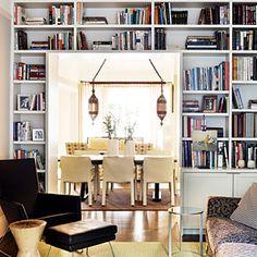 Bookshelves framing an entryway maximize vertical storage.