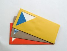 Cut out on Envelope to show a pop of color/design.