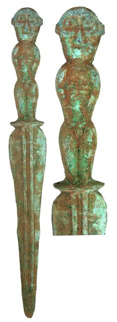 Ancient Asian Sword :    Bronze sword with the handle shaped as a standing figure with button-hole eyes, on side the body of a male with his hands to his sides, the other side a female with her arms across her chest.   400 - 200 BC