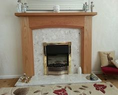 A 3 step arch oak fire surround that we made for Mr Wilkinson, it looks great against the existing marble set.