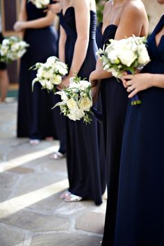 Dark navy dresses and white bouquets are an ever-elegant bridesmaids look at @Four Seasons Resort The Biltmore Santa Barbara.