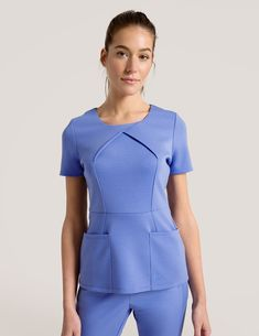 Envelope Pleat Top in Ceil Blue is a contemporary addition to women's medical scrub outfits. Shop Jaanuu for scrubs, lab coats and other medical apparel. Scrubs Outfit, Scrubs Uniform, Office Uniform For Women, Beauty Uniforms, Stylish Scrubs, Medical Uniforms, Medical Careers, Womens Scrubs, Nursing Clothes