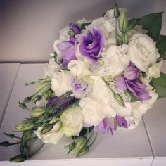 Rose, lisianthus and freesia bouquet.