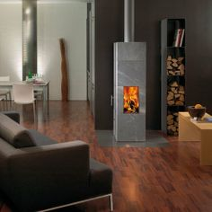 Gorgeous Soapstone Wood Stove Keeps You Warm For 15 Hours : TreeHugger * Narrow, nice. Foyers, Soapstone Wood Stove, Cooking Stove, Rocket Stoves, Fireplace Design, Small Living, Custom Homes, Interior Design, Thermal Mass