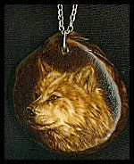 'Arctic Wolf' - Pyrography (woodburning) On Tagua  (Palm Ivory) slice;  jewelry / necklace. Sue Walters