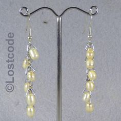 'Ivory chain of pearls earrings' is going up for auction at  4pm Fri, Jul 6 with a starting bid of $6.
