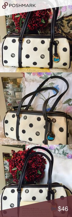 💕Dooney & Bourke Barrel Bag White with scribbled blue dots canvas bag. Cones with authenticity card and stamped inside the bag with its authenticity numbers. The inside of the bag is clean but outside needs cleaning. Signs of wear But overall condition....great bag! Leather handles are intact. Logo attached. Dooney & Bourke Bags Mini Bags