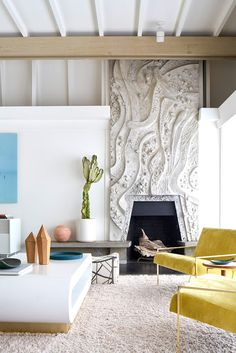Sunny Mid-Century Modern living room, cast concrete fireplace