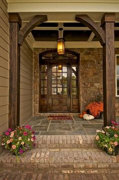 Exterior house porch ideas with stone columns (58)
