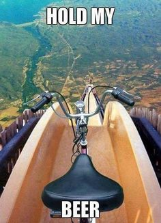 there is a teeny, tiny part of me that would really like to ride a bike down a water slide/flume...  This looks like fun...