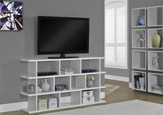 """White Hollow-Core 60"""" Horizontal / Vertical Etagere.  This Bold Contemporary """"Shift""""  Etagere / Tv Console Will Add A Stylish Storage Solution To Your Living Room, Office, Or Hallway. This Versatile Piece That Can Be Used Upright As A Bookshelf Or On Its Side As A Tv Console Is Finished In A Modern White. Thick Side Panels And Clean Lines Complete This Sleek Look. Open Shelves Offers Space For Books,  Decorative Items, Or Av Equipment..  Can Be Used As Bookcase Or A ..."""