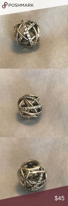 Pandora Galaxy charm Galaxy, clear CZ . 925 charm in excellent pre owned condition.  No stones missing. Price firm. Pandora Jewelry Bracelets