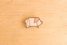 http://thelittledromstore.bigcartel.com/product/origami-pin-cat-pig