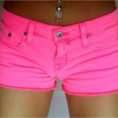 neon pink shorts + dream catcher bellybutton piercing <3