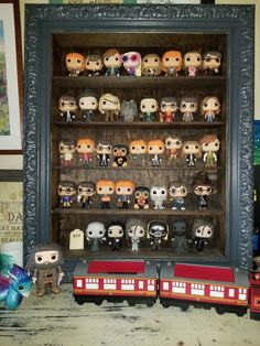 Harry potter pop vinyl display. I'm sad that there are no instructions on how to make this but it is amazing to look at and is sure to give people ideas.