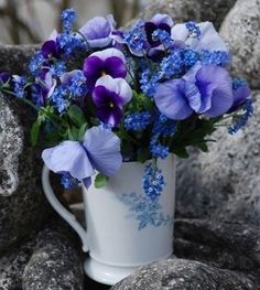 blue flowers in a white coffee mug. keep it simple. keep it stylish.