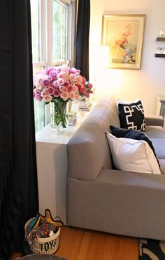 Skinny table behind sofa. Much better than having the sofa pressed against the window. Great idea!