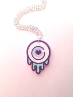 Pastel Black and Mint Dripping Eyeball Necklace by Clotique, £5.00