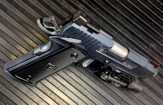 Salient Arms International 1911 (Commander length 1911 featured in 9mm but available in all the standard calibers.)