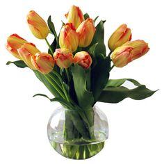 Faux orange tulip arrangement in a clear glass bubble vase.   Product: Faux floral arrangementConstruction Material: P...