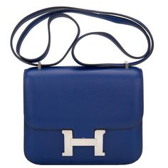 Hermes Blue Sapphire Swift Mini Constance 18cm | From a collection of rare vintage shoulder bags at https://www.1stdibs.com/fashion/handbags-purses-bags/shoulder-bags/