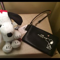 Coach Snoopy Wristlet Selling a NWT Coach Snoopy leather Wristlet. Super cute. Coach Bags Clutches & Wristlets