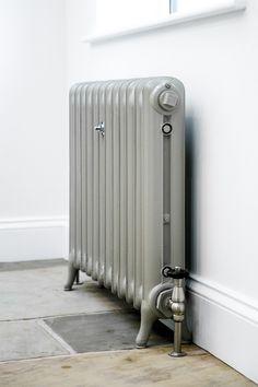 Duchess cast iron radiator painted in Little Greene Paint companies Serpentine